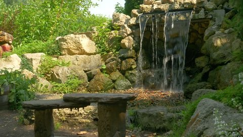 Man-Made Waterfall and Park Bench
