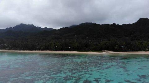 DRONE: Rarotonga flying towards beach on a clear day