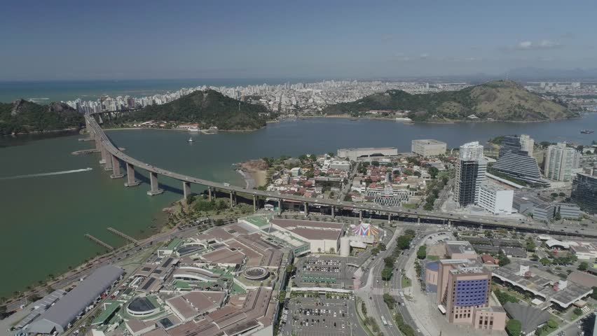 Drone tilt over the city of Vitoria. Shopping Victoria and Third bridge in the center. Convent of Penha and Penedo Hill in the background.