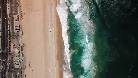 4K Drone Aerial of Huntington Beaches looking down on Pacific Ocean in California 4K Drone Aerial of Huntington Beaches looking down on Pacific Ocean in California Aerial flyover