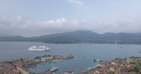 Aerial view of the port and the city of Portoferraio, a cruise ship entering in the harbor, Elba Island (Italy)