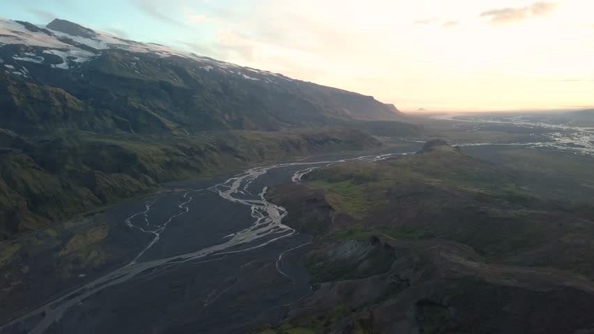 Beautiful aerial view looking over the famous Eyjafjallajokull in Thorsmork Iceland. Drone flies over the extraordinary Icelandic landscape. Big mountains, rivers dramatic valley and a glacier.