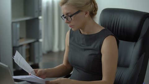 Pregnant office worker feeling strong pain in stomach, risk of misbirth, stress