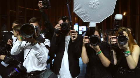 MOSCOW, RUSSIA – June, 5: Paparazzi are shooting celebrity. Slow motion. Flash light.