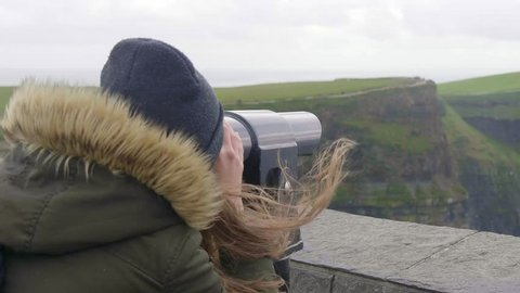 Watching the Cliffs of Moher in Ireland through a spyglass