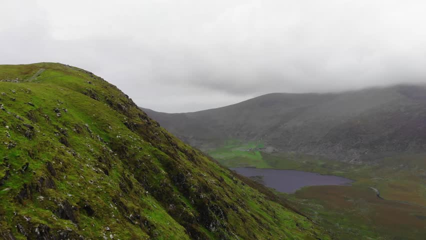Amazing flight over a valley at Dingle Peninsula in Ireland | Shutterstock HD Video #1016874544