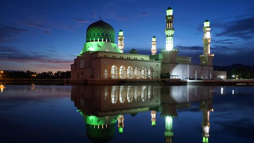 Timelapse of sunrise scenery near Likas Mosque or known as Masjid Bandaraya Likas in Sabah, Malaysia. Reflection on water. camera tilt down
