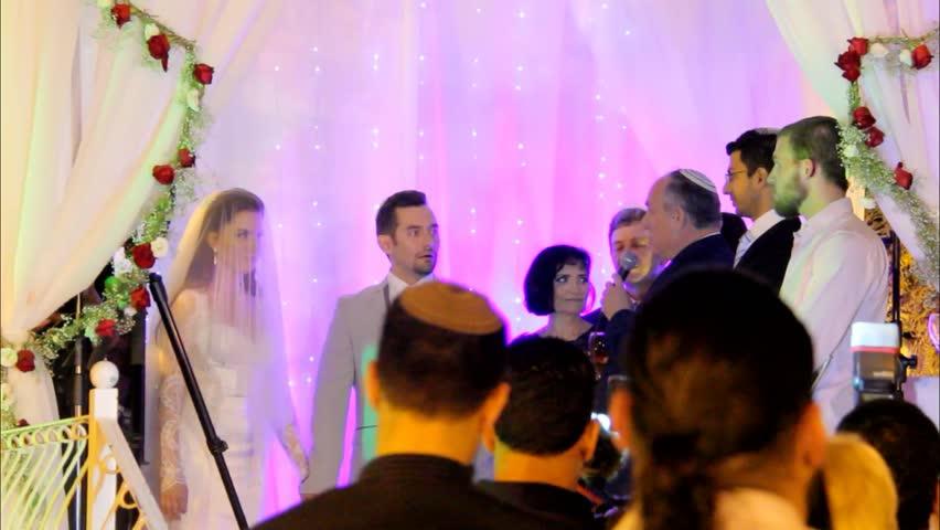 Tel Aviv, Israel - June 29, 2016: Jewish traditions wedding ceremony under chuppah