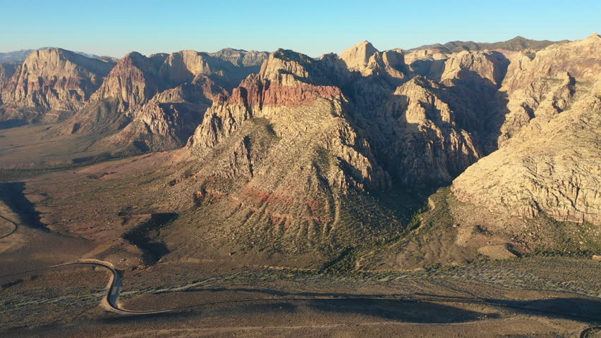 Dawn breaks on colorful mountains in Red Rock Canyon National Conservation Area, located near Las Vegas, NV. Its massive red rock geologic formations are popular for hiking and climbing.
