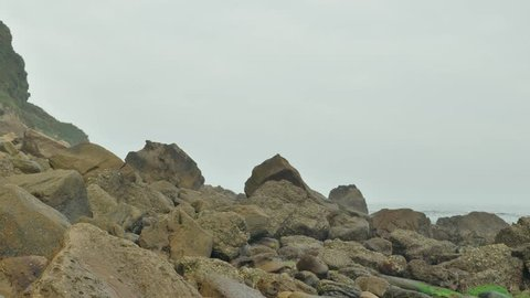 Wild rocky beach overcast at the cloudy day