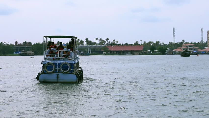 Alleppey, Kerala / India - 10 05 2014: ALLEPPEY, INDIA - OCTOBER 5, 2014: Tourists visit Alleppey sailing with a boat on Backwaters. India
