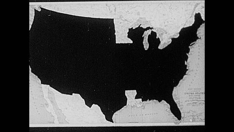 1930s: Map of the United States covered in black. Black cover is removed from individual states until the whole country is revealed.