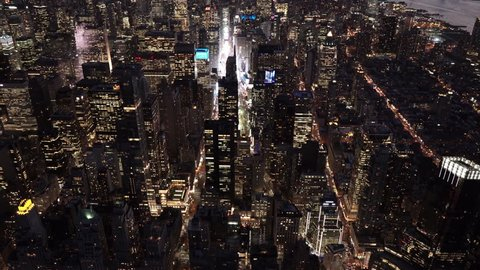 New York City Circa-2015, night aerial view tilting up from Columbus Circle featuring Midtown and Downtown Manhattan Skyline