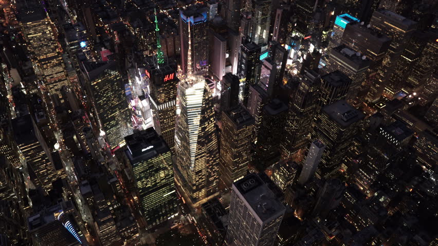 New York City Circa-2015, high angle aerial view of 42nd Street and 5th Avenue at night with Times Square in background