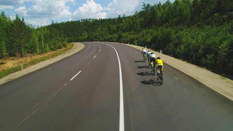 Aerial view of road cyclists. Red Bull Trans-Siberian Extreme 4k