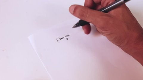 "Hand writing ""I love you. I miss you."""