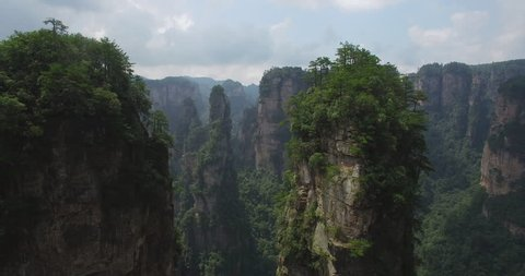 Amazing mountain aerial view. Flying through the spectacular mountain landscape of Zhangjiajie, a national park in China known for its surreal scenery of rock formations.