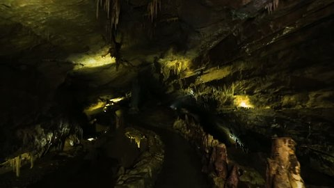 Inside dark cave with yellow light in Caucasian mountains in Kutaisi, Georgia