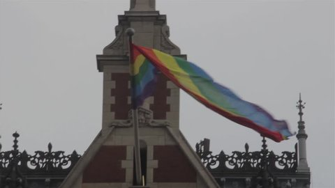 Rainbow Flag / Pride Flag / LGBT Flag Waving / Fluttering at Amsterdam Central