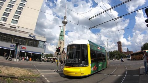 Berlin, Germany-11 July, 2018: 4K. The tram is passing near Rotes Rathaus (Red City Hall) in Berlin. Camera movement towards the Fernsehturm Television Tower-Adrian