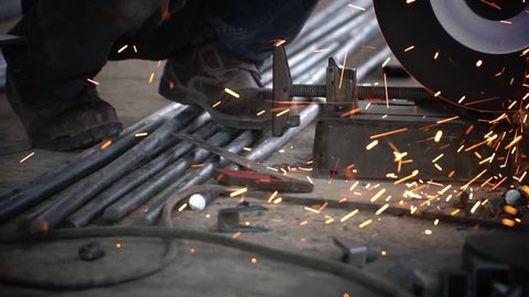 blacksmith or welder,with its grinding smooths steel and iron,in extreme slow motion,to make the surface smooth.