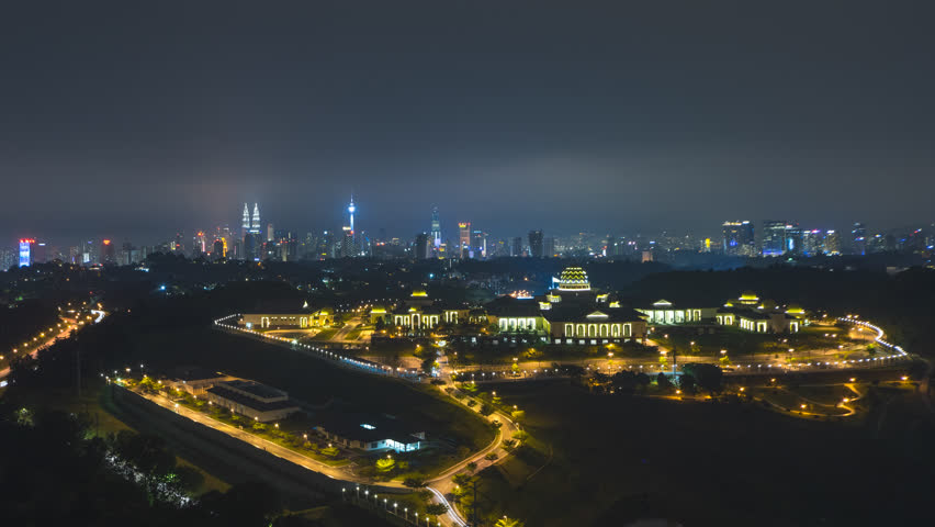 Time lapse: Dramatic night aerial view of the Kuala Lumpur skyline with the Malaysia national palace in the foreground and the national landmarks in the background. Zoom out. Prores 4K | Shutterstock HD Video #1017163954