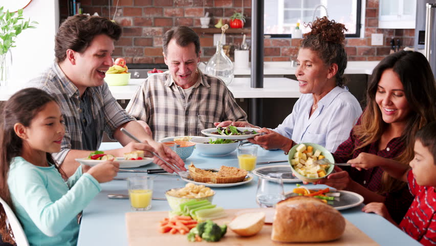 Multi Generation Family Enjoying Meal Around Table At Home | Shutterstock HD Video #1017166954
