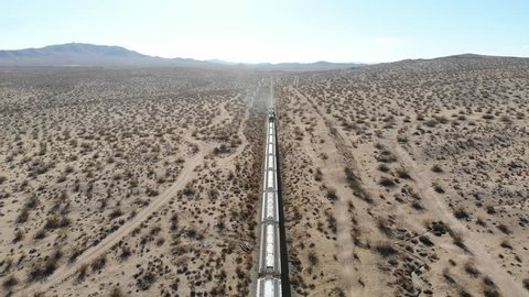 Aerial Drone Views Flying Over Train Going Through Mojave Desert Dry Lands