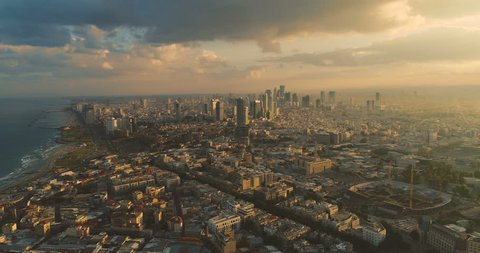 Tel Aviv Skyline from Drone. Aerial shot long super wide horizon view. Sunset orange Sky coastline and office building in a modern Tel Aviv