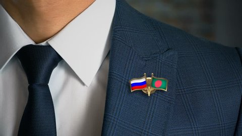 Businessman Walking Towards Camera With Friend Country Flags Pin Russia - Bangladesh