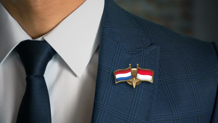 Businessman Walking Towards Camera With Friend Country Flags Pin Netherlands - Monaco