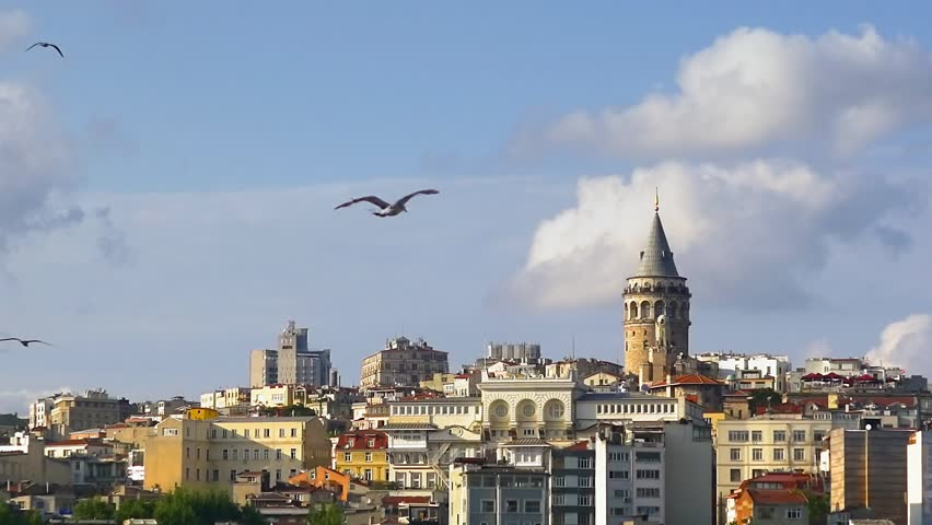 Istanbul, Galata Tower with the birds. Amazing tower built in the 14th century by the Genoese colony as part of defense wall surrounding their district at Galata directly opposite ancient Constantinop