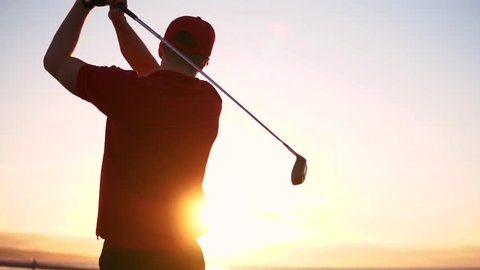 Cinematic Male Golfer At Sunset, Slow Motion Golf Swing Drive Shot.