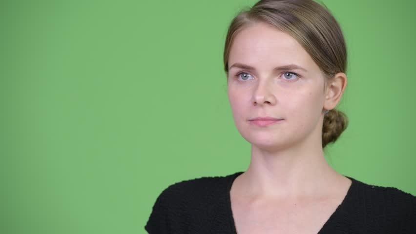Head shot of young beautiful businesswoman thinking   Shutterstock HD Video #1017335794