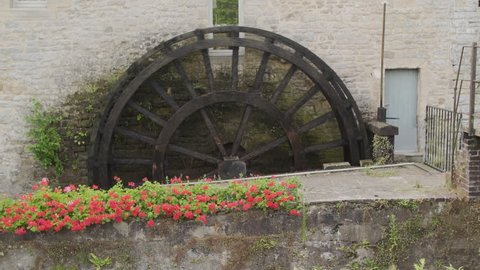 Working water wheel in Bayeux, Normany, France.