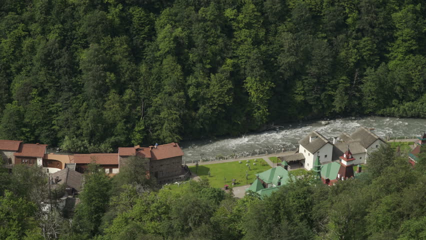 Aerial view of mountain river near the ski resort in summer | Shutterstock HD Video #1017417454