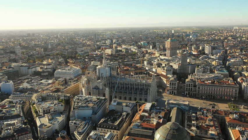 Aerial panoramic view of cityscape of Milan, historic part of city with gothic Milan Cathedral, landscape panorama of Italy from above, Europe | Shutterstock HD Video #1017429424