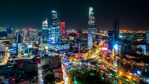 Ho Chi Minh City, Vietnam - June 14, 2018: Time lapse view of Ho Chi Minh City aka Saigon, Vietnam, showing landmark buildings and traffic in the financial district at night. Zoom out.