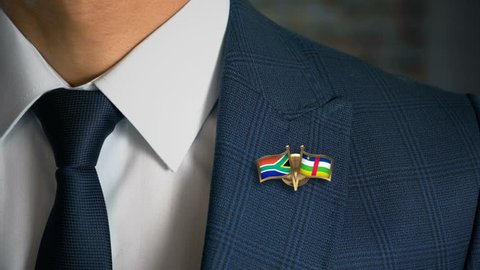 Businessman Walking Towards Camera With Friend Country Flags Pin South Africa - Central African Republic