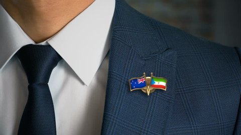 Businessman Walking Towards Camera With Friend Country Flags Pin New Zealand - Equatorial Guinea