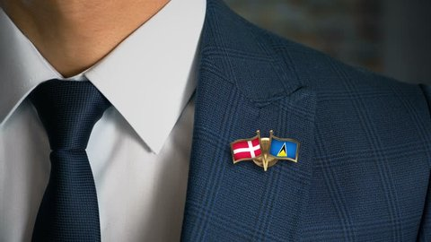Businessman Walking Towards Camera With Friend Country Flags Pin Denmark - Saint Lucia