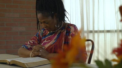 Bible study and scripture reading leads to fervent prayer for this lovely African American woman