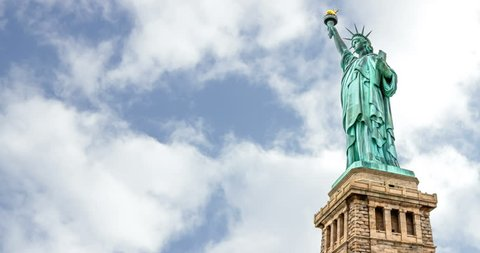 New York, The Statue of Liberty. Patriotic symbol rapid clouds sky time lapse