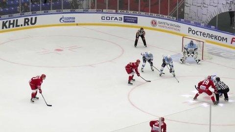 PODOLSK - SEPTEMBER 30, 2018: A. Krasikov (84) miss a score on hockey game Vityaz vs Sibir Novosibirsk on Russia KHL championship on September 28, 2018, in Podolsk, Russia
