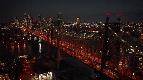 dusk orbiting Queensboro Bridge from LIC to NYC