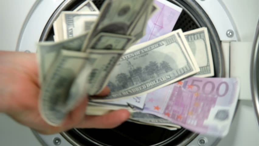 Man puts money in the washing machine, dollars and euros, closeup | Shutterstock HD Video #1017629194