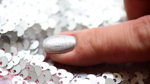 Woman hand with fashion famous manicure  silver glitter sequins paillette spangle shine