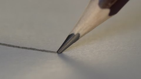 Artist hand drawing a flat gray line with a graphite wooden pencil on white paper. Close up, macro, 4k