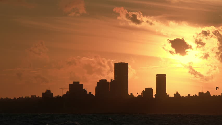 Timelapse of a sunset looking at a City's skyline. Montevideo, Uruguay