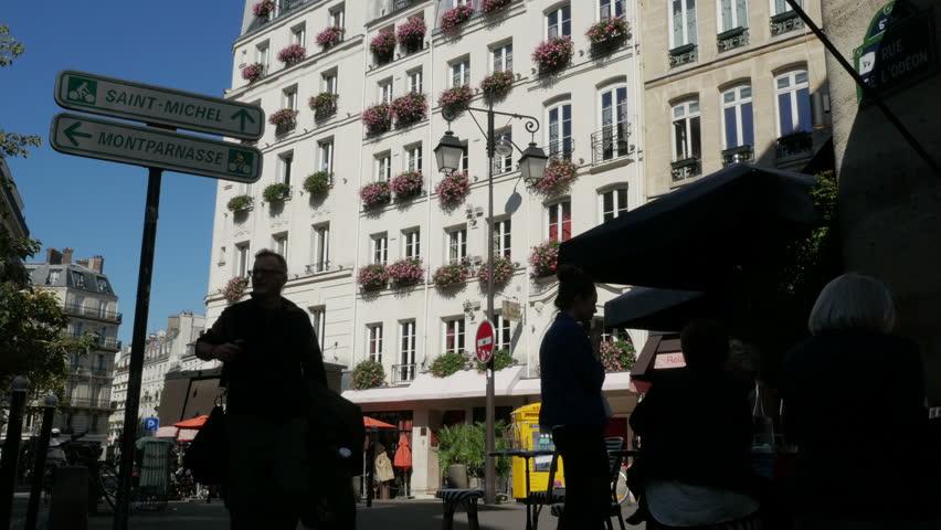 Paris, France - September 2018. Street scene of people and local architecture of Carrefour de l'Odéon, Rue de l'Odéon, Saint-Germain-des-Prés, 6th arrondissement, Paris, France